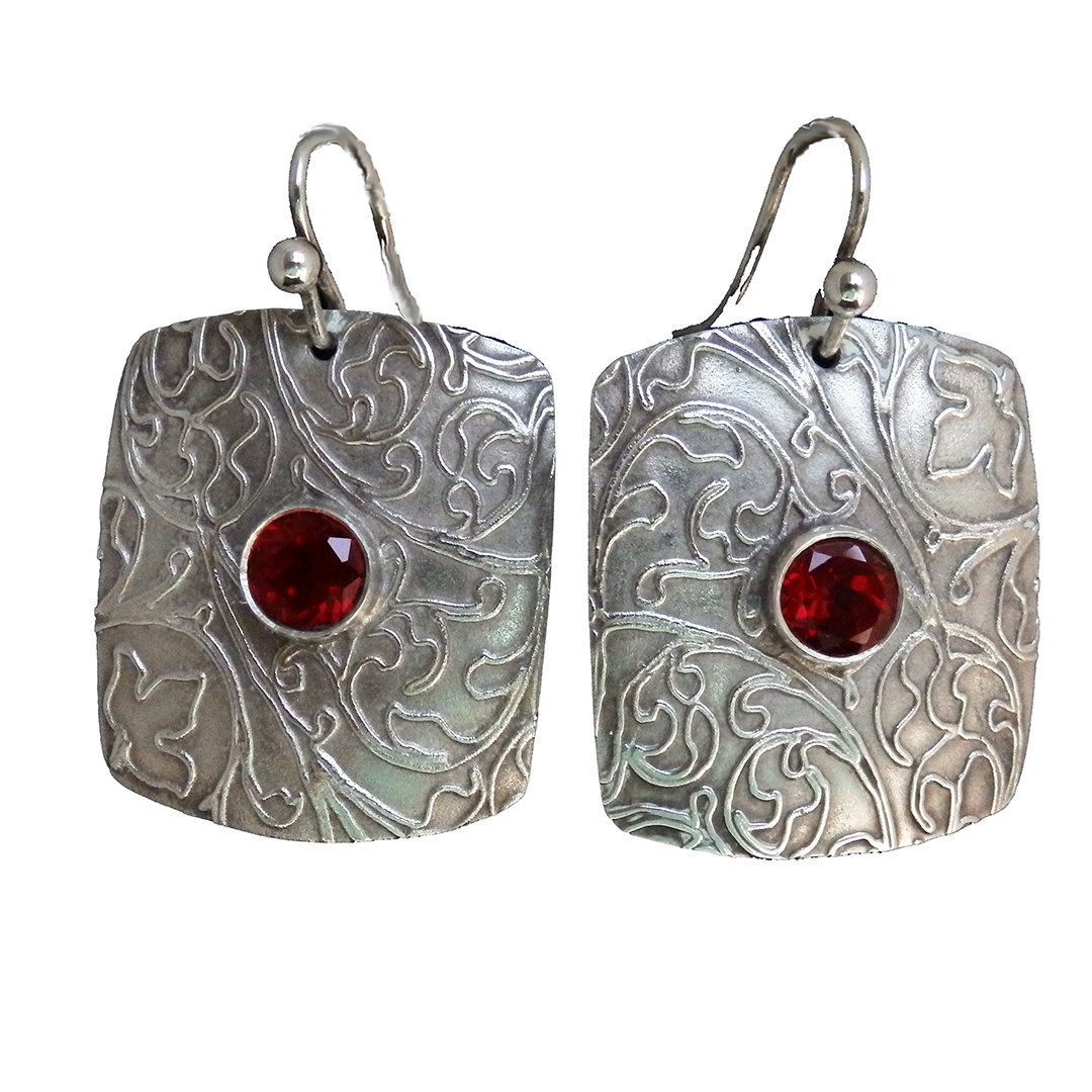 Garnets set in Embossed Silver